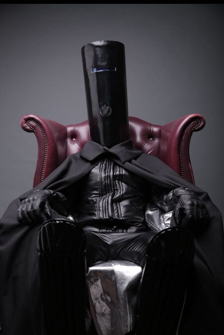 One day, one picture 213603678145973657-buckethead-in-chair.full