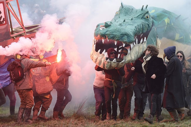 Original Opponents to the former Notre-Dame-des-Landes (NDDL) airport project, holding a crocodile puppet, parade during a rally to celebrate the government's decision to stop the construction of the airport at the ZAD ('zone a defendre', zone to defend) in Notre-Dame-des-Landes, north of Nantes, western France, on February 10, 2018. Thousands of opponents of the former Notre-Dame-des-Landes airport project are expected to celebrate on February 10 the 'historic victory' obtained after 50 years of protest and to reaffirm their determination to win a second battle, that of the collective management of land 'saved from concrete'. / AFP PHOTO / Jean-Sebastien EVRARD