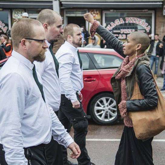 cover woman at a nazi demo borlange sweden dpa