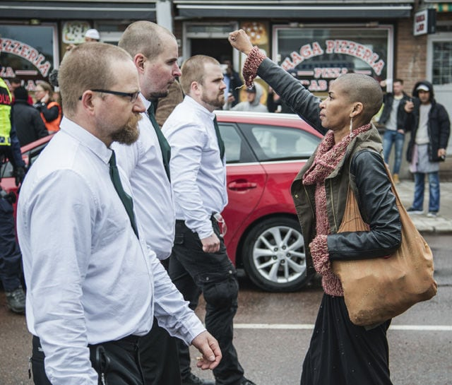 cover woman at a nazi demo borlange sweden dpa